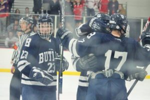 Sophomore defensemen celebrates 1 of his 2 goals of Friday night (Photo by James Longstreth).